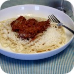 Beef stewed in tomato sauce with noodles